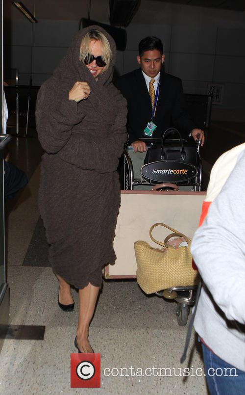 Pamela Anderson arrives on a flight to Los...
