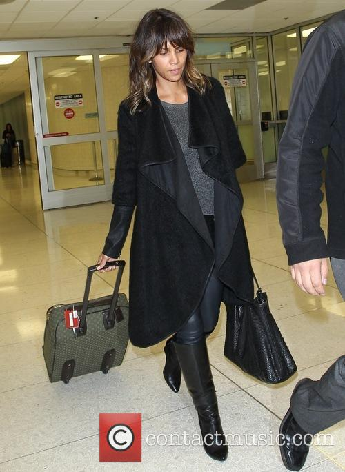 Halle Berry arrives at Los Angeles International (LAX)...