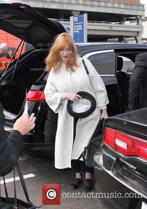 Christina Hendricks arrives at Los Angeles International Airport...