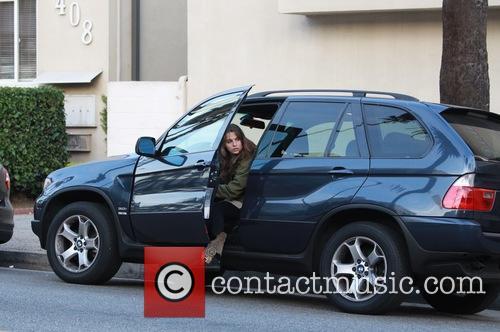 Actress Melia Kreiling runs across a busy street...
