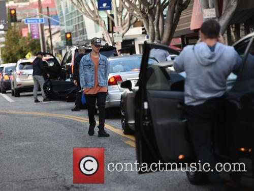 Justin Bieber gets out of his car to...