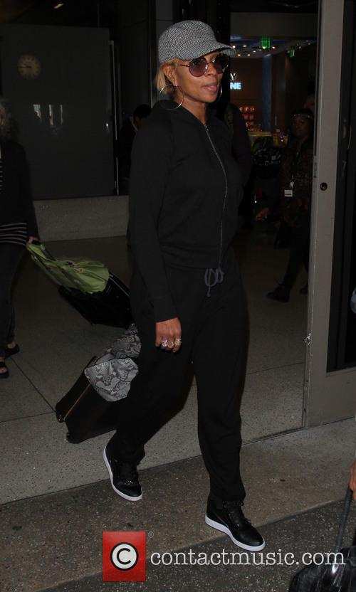 Mary J. Blige arrives on a flight to...