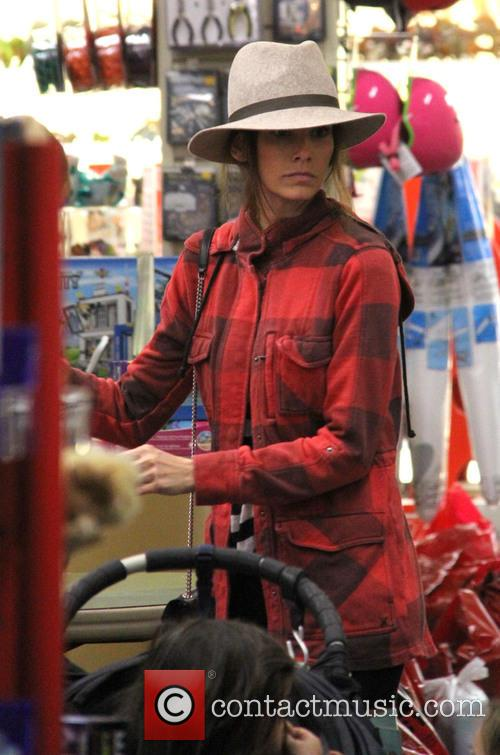 Jordana Brewster goes christmas shopping at Tom's Toys...