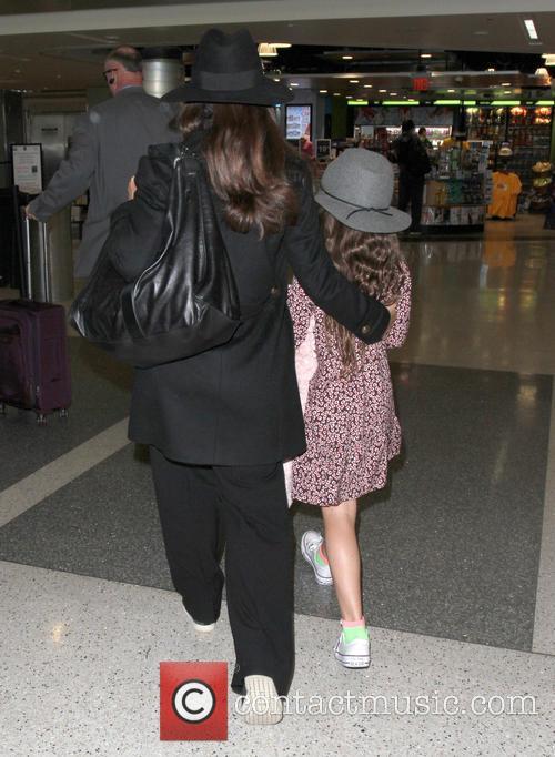 Salma Hayek arrives at Los Angeles International Airport...