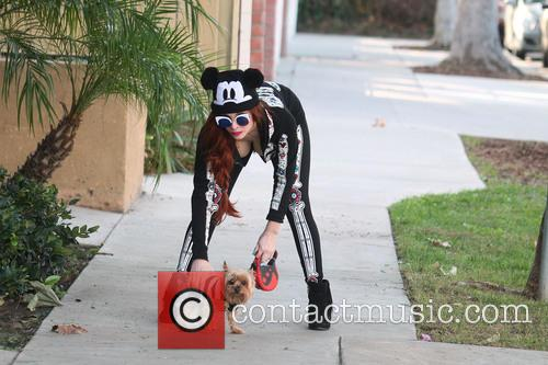 Phoebe Price wearing a Halloween outfit two days...