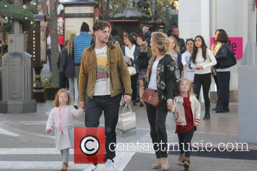 Aaron and Sam Taylor-Johnson take their daughter's shopping...