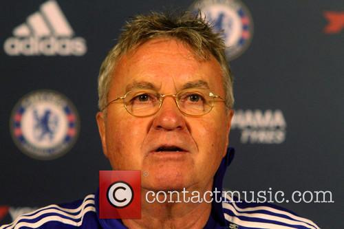 Guus Hiddink attends his first press conference as...