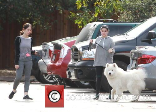 Ariel Winter goes hiking with her dog in...