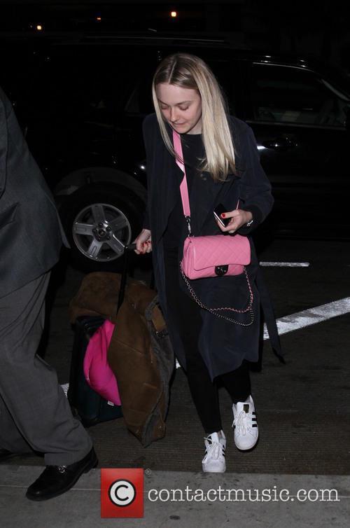 Dakota Fanning departs from Los Angeles International Airport...