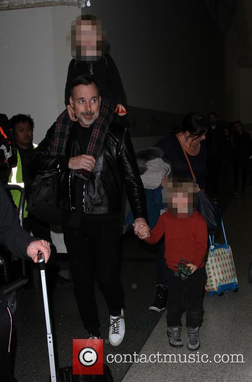 David Furnish departs on a flight from Los...