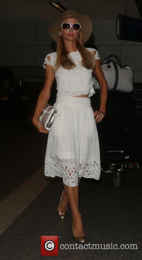 Paris Hilton arrives on a flight to Los...
