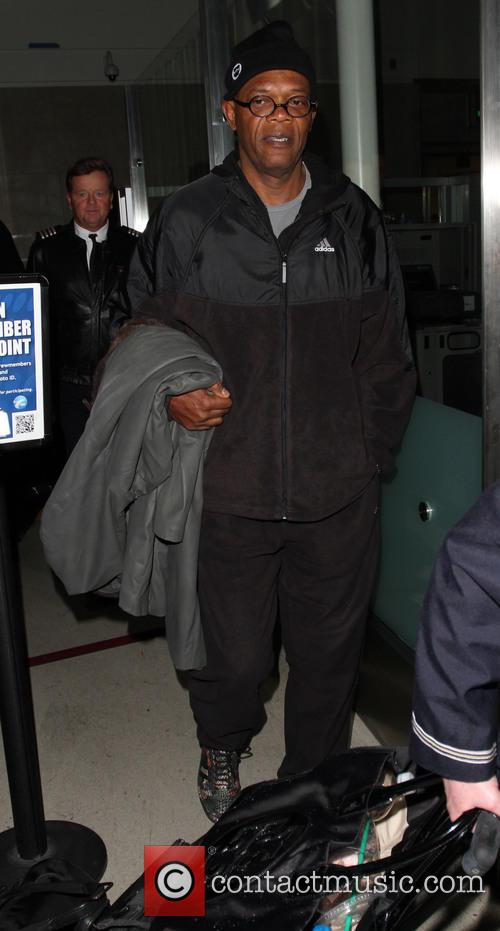 Samuel L. Jackson arrives on a flight to...