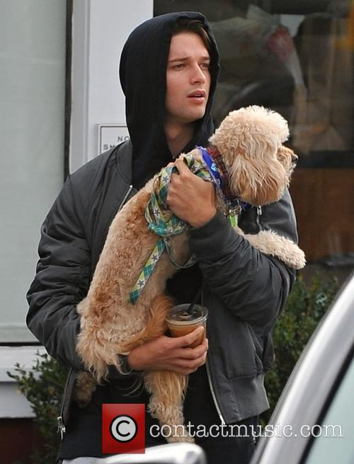 Patrick Schwarzenegger leaves a restaurant with his dog...