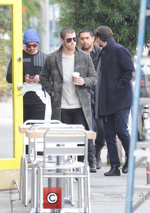 The Jonas Brothers out and about getting a...