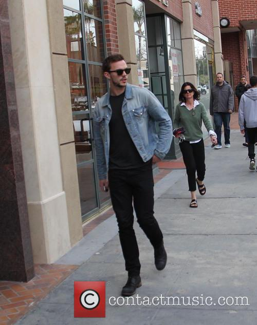 Nicholas Hoult spotted walking and getting into his...
