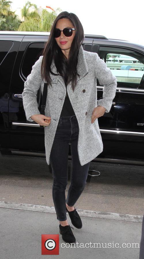Olivia Munn departs on a flight from Los...