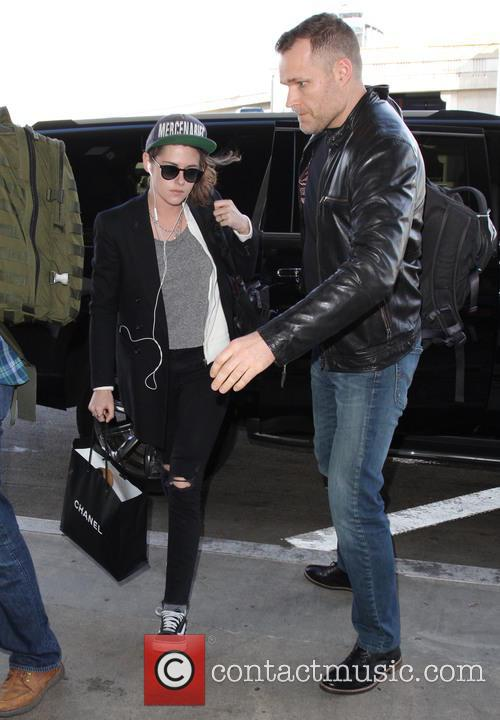 Kristen Stewart arrives on a flight to Los...