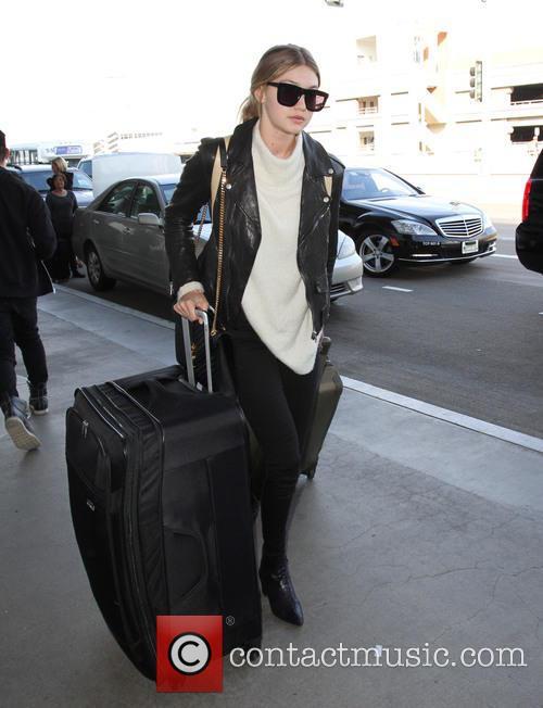 Gigi Hadid arrives at Los Angeles International Airport...