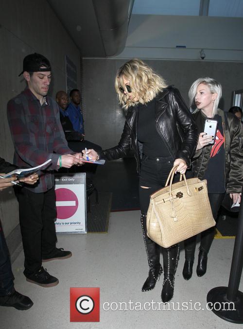 Khloe Kardashian arrives at Los Angeles International Airport...