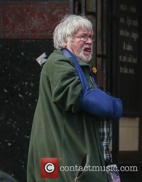 Bill Oddie out and about, wearing a blue...
