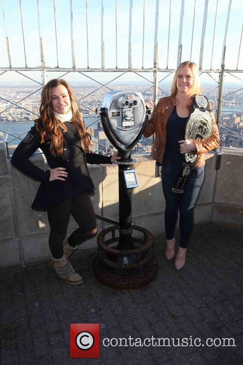 Miesha Tate and Holly Holm 7
