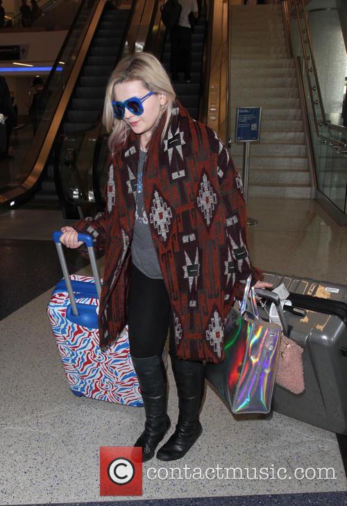 Abigail Breslin arrives at Los Angeles International Airport...