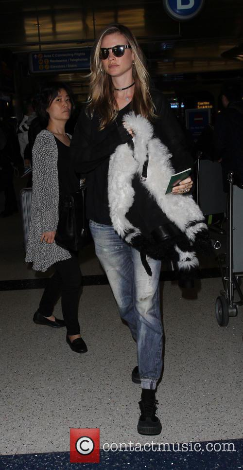 Behati Prinsloo arrives on a flight from Paris...