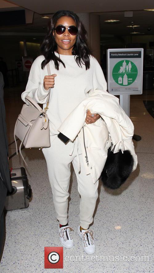 Gabrielle Union arrives on a flight to Los...