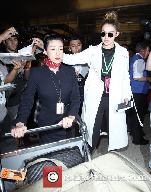 Gigi Hadid arrives on a flight to Los...