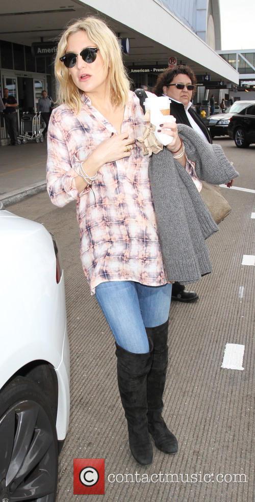 Kate Hudson arrives on a flight to Los...