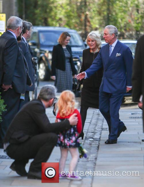The Prince of Wales, accompanied by Camilla, Duchess...