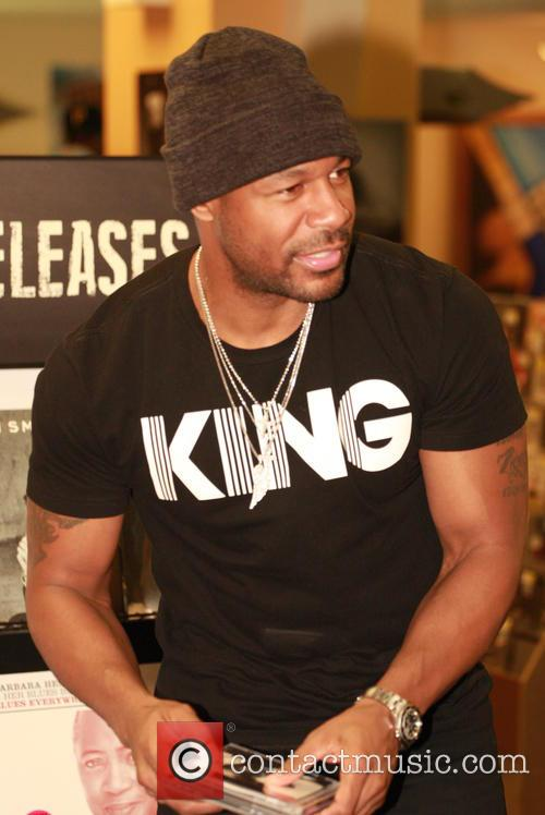 R&B Artist Tank signs copies of his new...