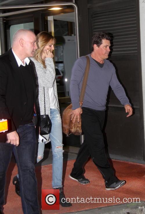 Josh Brolin and girlfriend arriving at Tegel airport