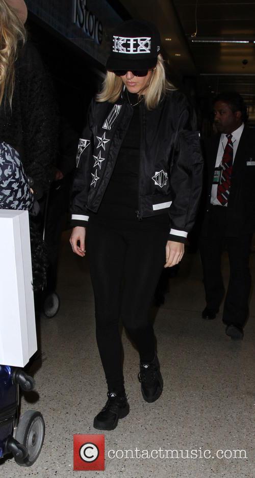 Ellie Goulding arrives on a flight to Los...