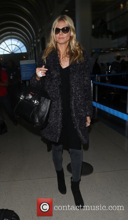 Heidi Klum arrives on a flight to Los...