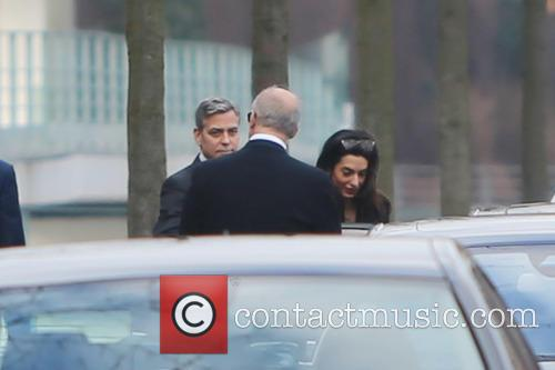 George Clooney and Amal 6