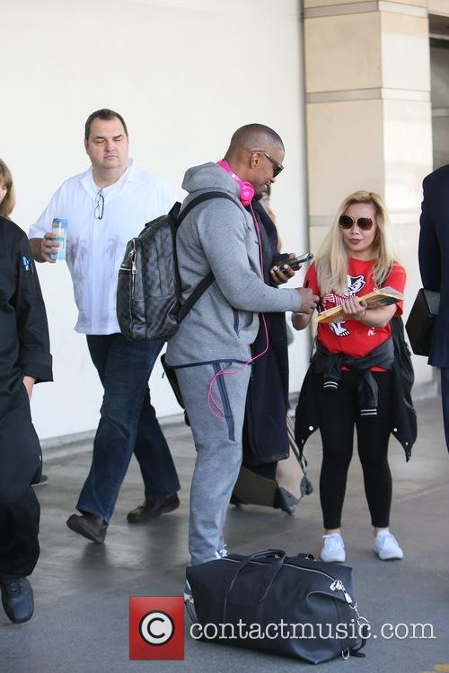 Jamie Foxx arrives at Los Angeles International Airport...
