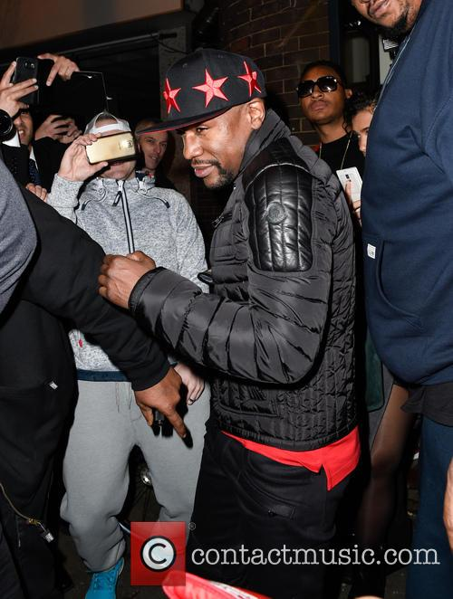 Floyd Mayweather Jr. is mobbed by fans after...