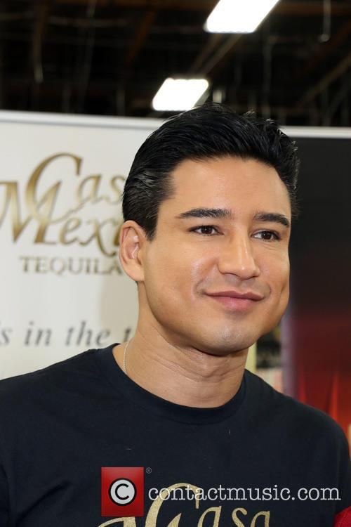 Mario Lopez signs bottles of Casa Mexico Tequila...
