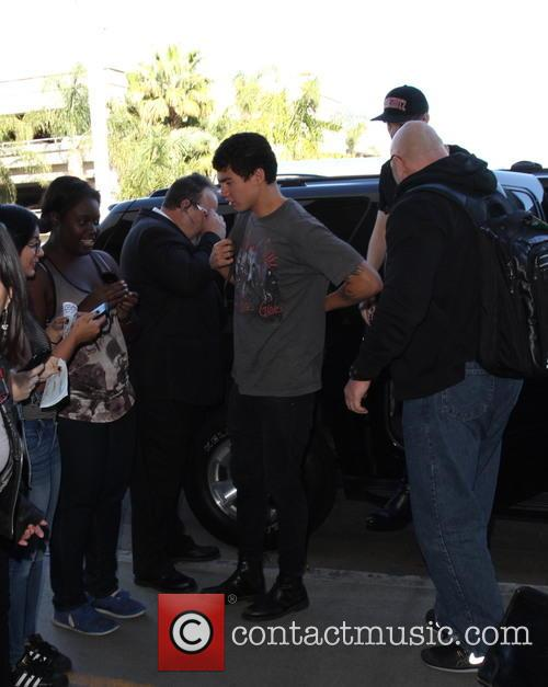 5 Seconds of Summer departs on a flight...