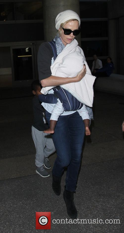 Charlize Theron arrives on a flight to Los...