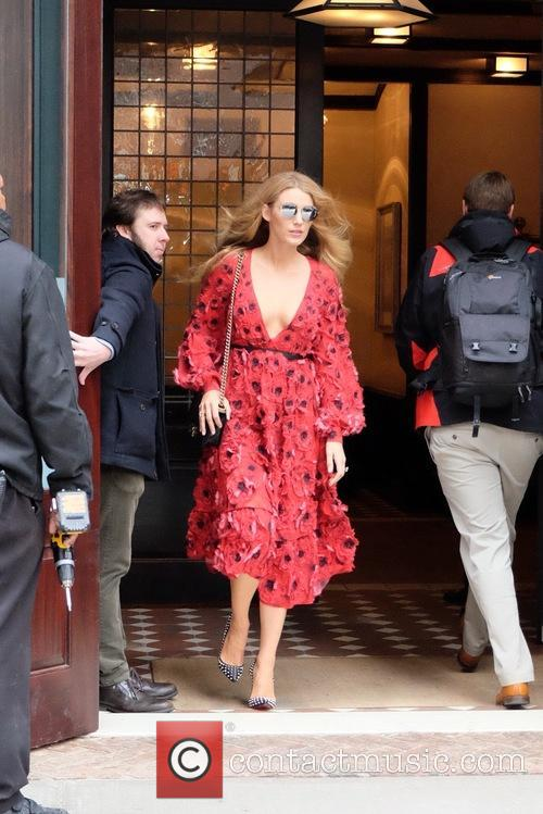 Blake Lively leaving her hotel in a red...