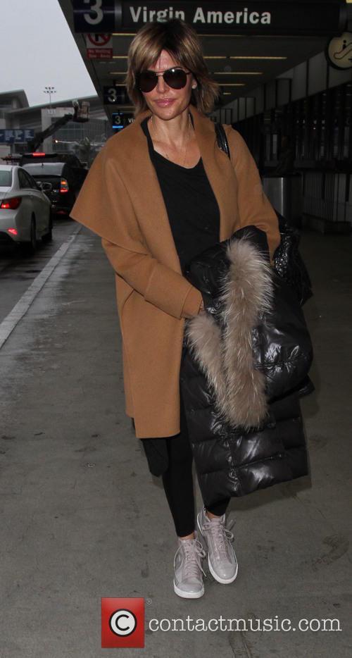 Lisa Rinna arrives on a flight to Los...