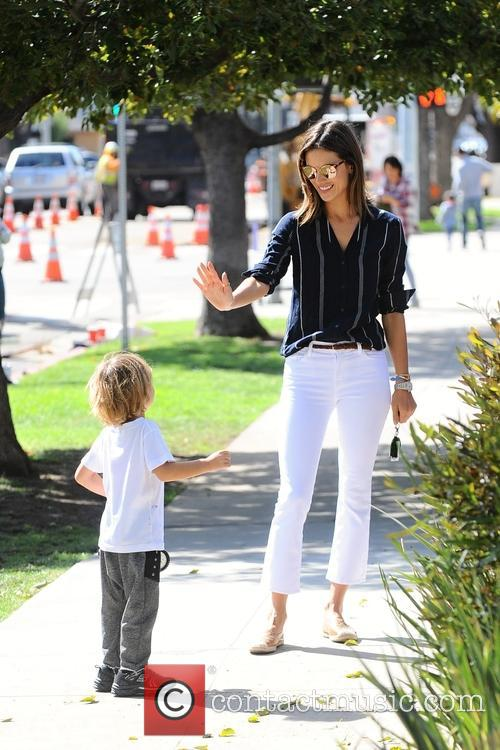 Alessandra Ambrosio pick up her son