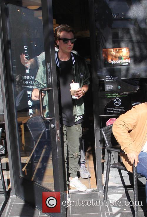Jonathan Cheban pick up coffee to-go in Beverly...