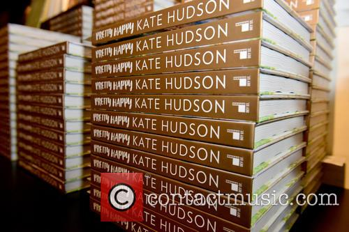 Kate Hudson signs copies of her new book...