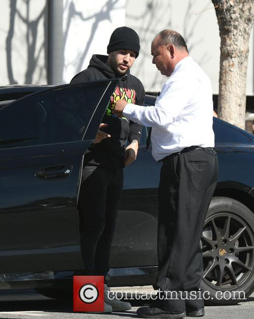 Pete Wentz leaves his car with the valet...