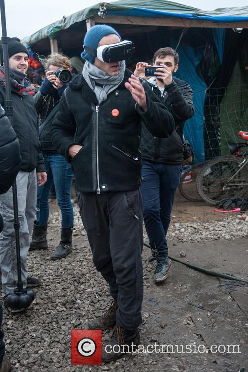 Jude Law visits the Calais Jungle Refugee Camp