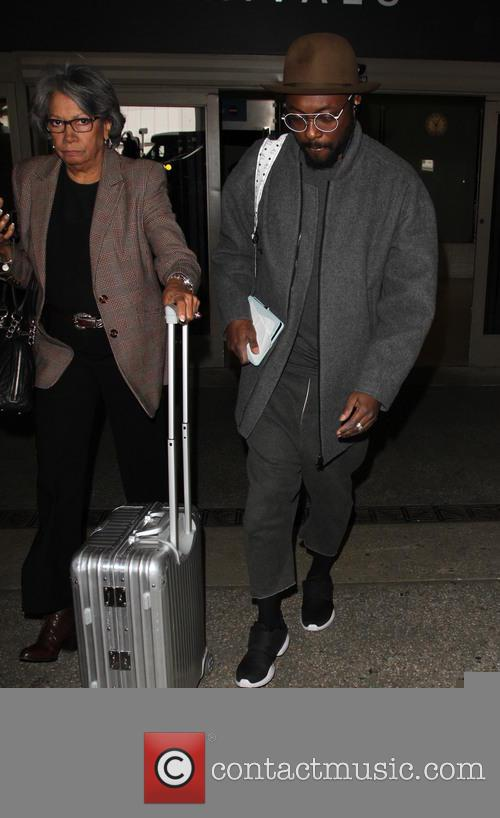 will.i.am arrives on a flight to Los Angeles...