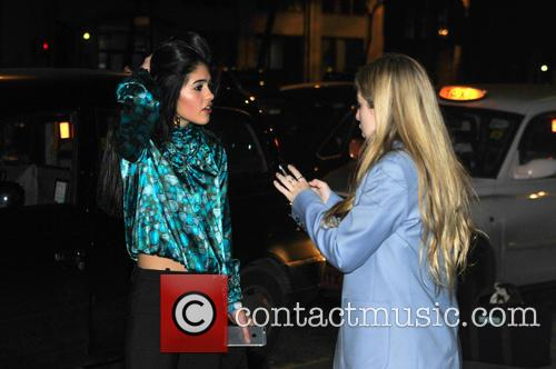 Anais Gallagher appears animated outside Universal BRIT Awards...